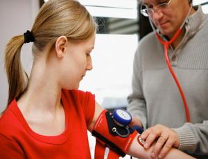 Teenage Girl Having Her Blood Pressure Checked