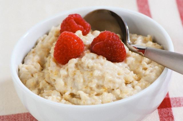 Porridge with fresh raspberries in a bowl
